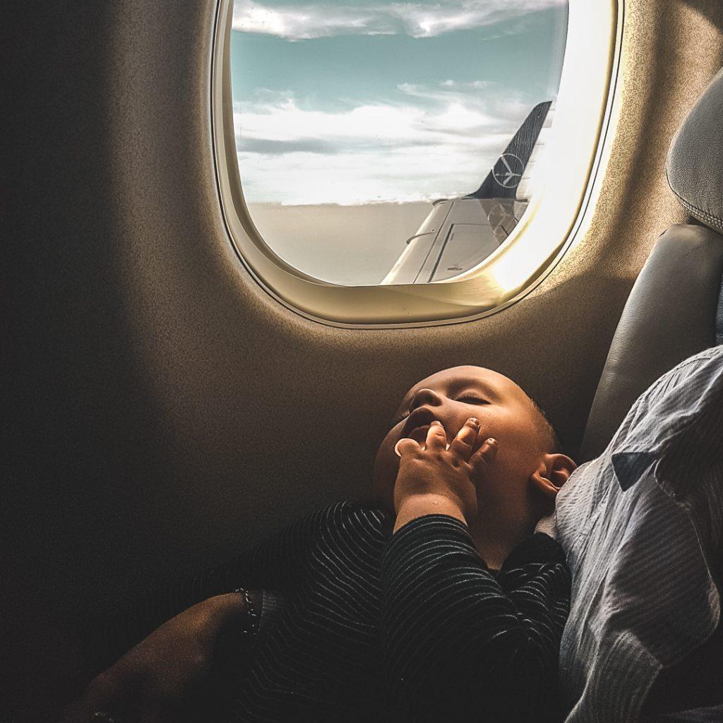baby on plane sleeping