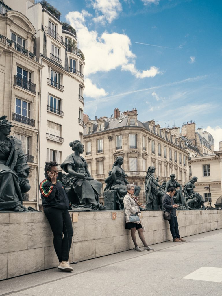 people are statues paris