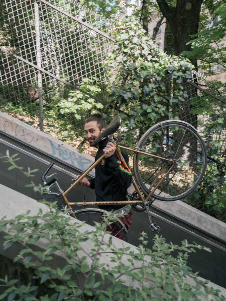 man with bike paris